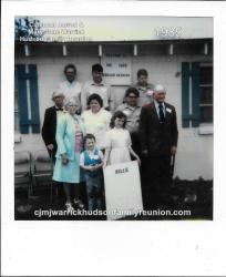 1985 - Family of Hollie: First Row: Lossie Hudson Shipp, Aaron Mozingo, Michelle Mozingo (holding family sign) Second Ro