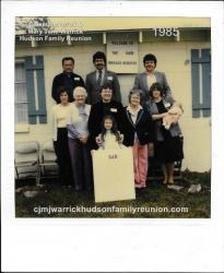 1985 - Family of Sam: First Row: Kimberly Ann Hudson (holding family sign) Second Row: Sue Jones Sutton, Juanita Hudson